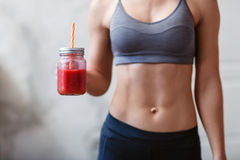 Fitness and healthy lifestyle concept with detox smoothie Stock Photography
