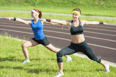Fitness and Healthy Lifestyle Ideas and Concepts. Two Caucasian Girlfriends Having Arms Stretching Exercises Stock Image