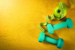 Fitness and healthy nutrition concept on yellow background Stock Photography