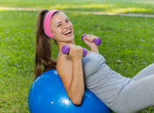 Fitness Healthy Smiling Young Woman Resting on Pilates Ball Stock Image