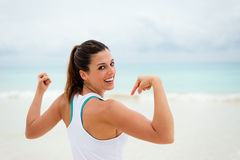 Fitness healthy woman showing biceps Stock Images