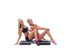 Fitness. Image of blond twins posing in studio Stock Image