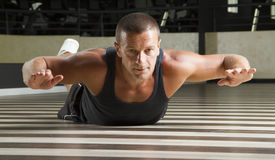 Fitness instructor doing abs exercise. On his stomach Royalty Free Stock Photo