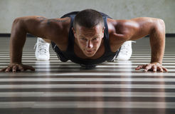Fitness instructor doing push ups Stock Photos
