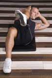Fitness instructor doing sit-ups Stock Image
