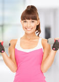 Fitness instructor with dumbbells Stock Image