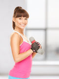 Fitness instructor with dumbbells Stock Photography