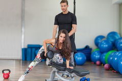 Fitness instructor exercising with his client Royalty Free Stock Photo