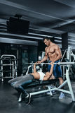 Fitness instructor exercising with his client at the gym. Royalty Free Stock Photos