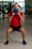 Fitness Instructor Exercising With Kettle-bell Stock Photo