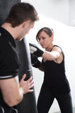 Fitness Instructor with female client Stock Image