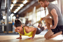 Fitness instructor with girl on training Royalty Free Stock Images