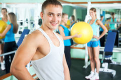 Fitness instructor with gym people Stock Photos