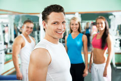 Fitness instructor with gym people Royalty Free Stock Photos