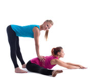 Fitness instructor help woman doing stretch Stock Images