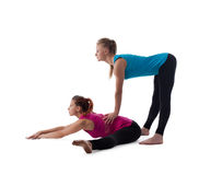 Fitness instructor help woman exercise stretch Royalty Free Stock Image