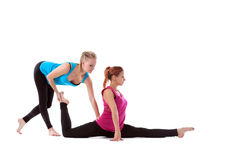 Fitness instructor help young woman doing stretch Stock Photos