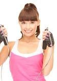 Fitness instructor with jump rope Stock Photo