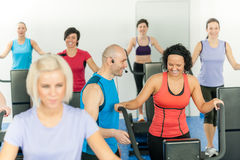 Fitness instructor leading class of alpinning Stock Photography