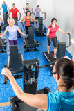 Fitness instructor leading treadmill running class Stock Images