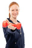 Fitness instructor offering weight Stock Photography