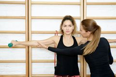 Fitness instructor. Personal trainer helping. Stock Images