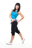 Fitness instructor posing with dumbbells Stock Photography