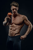 Fitness instructor reminds drink fluids after exercise Stock Image