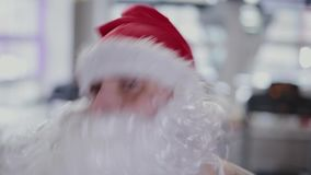 Fitness instructor Santa Claus in the gym on the simulator, face close-up. stock footage