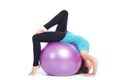 Fitness instructor,shows exercises with a large ball. Stock Photos