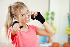 Fitness instructor. Smiling female fitness instructor p[ointing on you with a finger Stock Photo