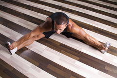 Fitness instructor streching his legs Royalty Free Stock Image