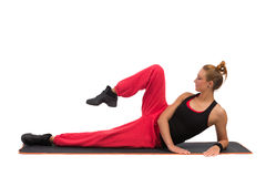 Fitness instructor stretching on exercise mat Stock Photo
