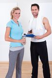 Fitness instructor taking notes after a session Stock Image