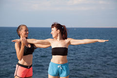 Fitness instructor teaches a woman to play sports stock image
