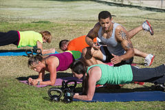 Fitness Instructor Timing Students Royalty Free Stock Photo