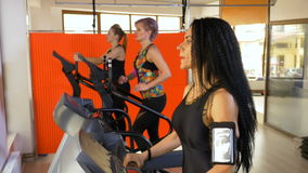 Fitness instructor training on treadmill setting up smartphone tracking app stock video