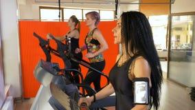 Fitness instructor training on treadmill setting up smartphone tracking app. Fitness instructor training on the treadmill setting up smartphone tracking app stock video