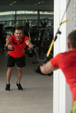 Fitness Instructor Training With Trx Fitness Straps Royalty Free Stock Photography
