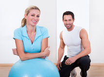 Fitness instructor and woman Royalty Free Stock Photo