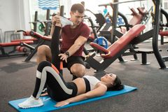 Fitness Instructor Working with Client stock images