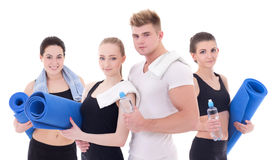 Fitness instructor and young beautiful women with yoga mat isola Royalty Free Stock Image