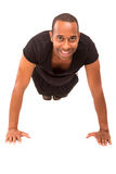 Fitness instructor. A young and handsome african fitness instructor Royalty Free Stock Photos