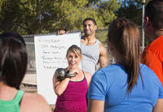 Fitness Instructors with List of Exercises. Fitness instructors explaining a list of exercises Stock Photo