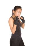 Fitness instructress in defence stance. Female fitness instructress in defence stance, both fist held close to upper body, isolated Royalty Free Stock Image