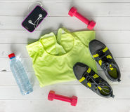 Fitness items on wooden planks background Royalty Free Stock Images