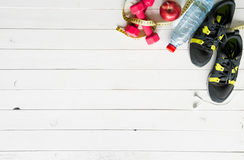 Fitness items on wooden planks background with Royalty Free Stock Images