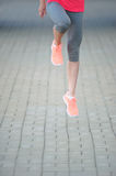 Fitness jogger legs in jump at park. Woman fitness jogging workout wellness concept. royalty free stock images