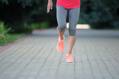 Fitness jogger legs running at park. woman fitness jogging workout wellness concept. royalty free stock photos