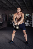 Fitness Kettlebells swing exercise man workout Stock Photos